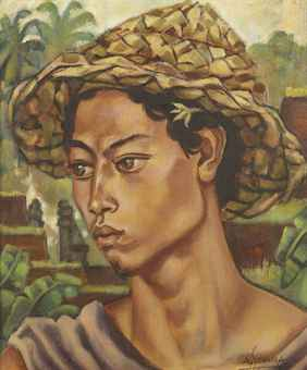 A Balinese boy with a sun hat